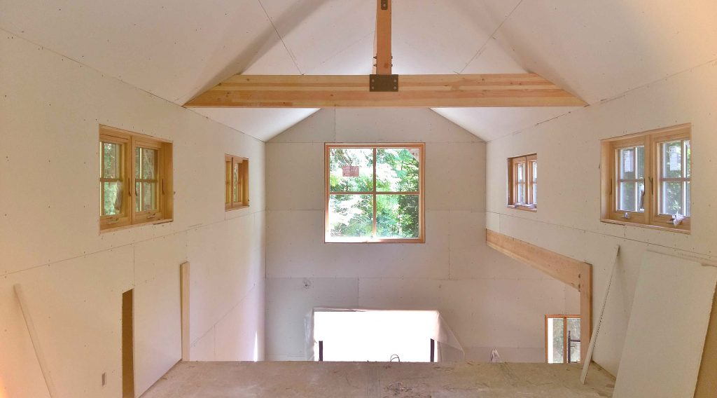 View from loft to double height dining room