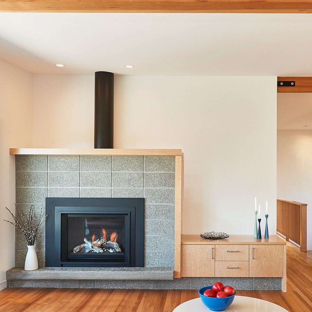 Scandinavian modern concrete block fireplace at the MidCentury-Move house remodel.