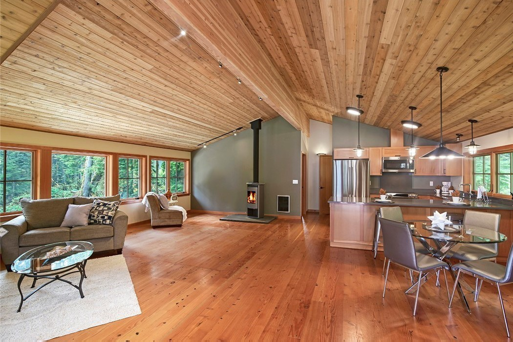 Kitsap lodge in the woods great room with vaulted wood panel ceilings