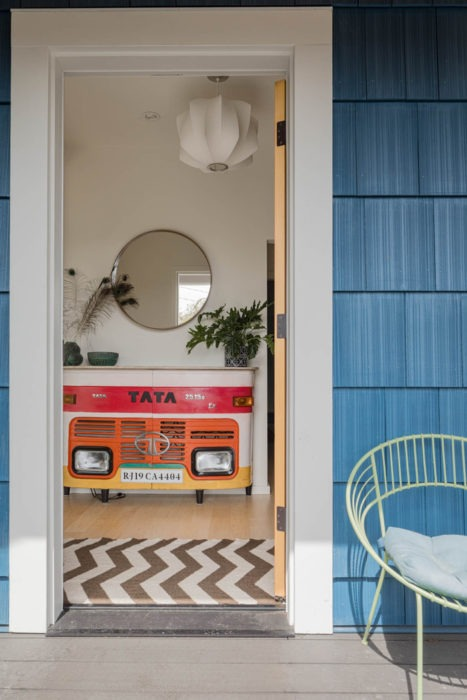 Front entryway to the Wallingford Urban Farmhouse featuring a fun vintage shelf made from the front of an old tata motorcar.