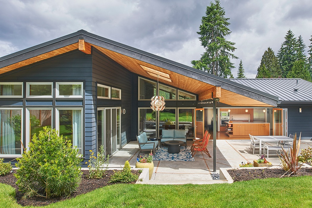 kirkland seattle Mid Century remodel covered patio with vaulted ceiling, exposed beams, and folding doors