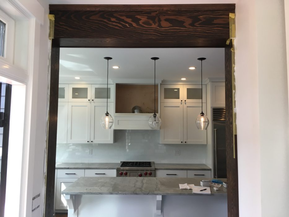 finishing touches on a remodeled kitchen in a queen anne classic craftsman