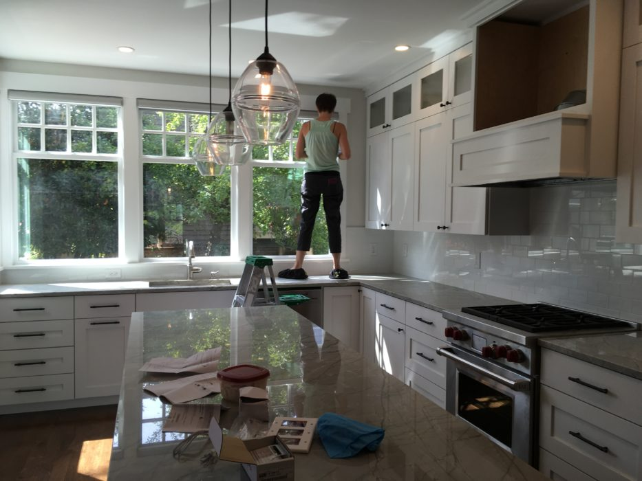 putting the final touches on a remodeled kitchen