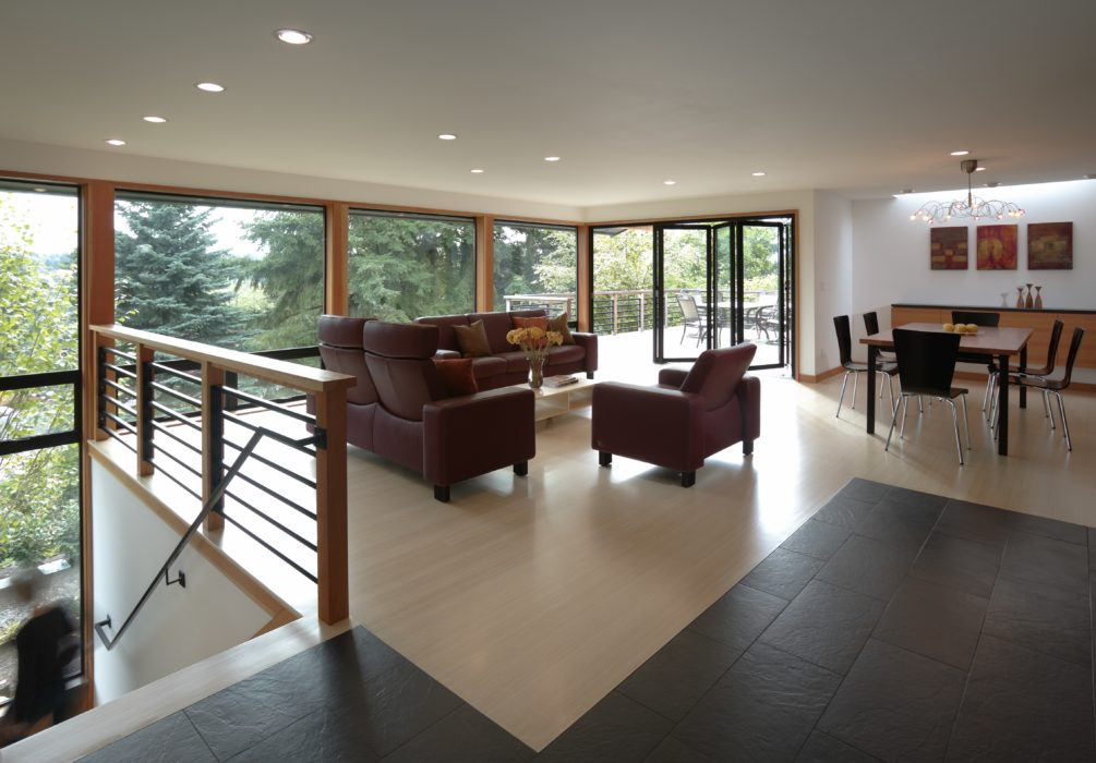 living space and stairwell with views to outside